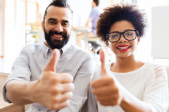 Happy creative team in office showing thumbs up Royalty Free Stock Photo
