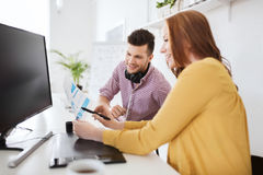 Happy creative team with papers at office Royalty Free Stock Image
