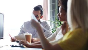 Happy creative team with papers talking in office stock footage