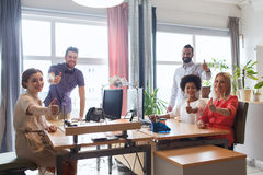 Happy creative team showing thumbs up in office Royalty Free Stock Photography