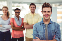 Happy creative team standing together. In casual office royalty free stock image