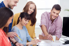 Happy creative team or students working at office Royalty Free Stock Image