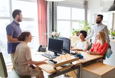 Happy creative team talking in office Royalty Free Stock Photo