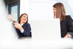 Happy creative women talking at office Royalty Free Stock Image