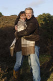 Happy cuddling couple Stock Photo