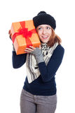Happy curious winter woman with present Royalty Free Stock Images