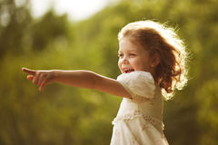 Happy curly girl showing hand forward Stock Image
