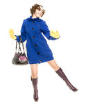 Happy curly-haired woman in coat Stock Image