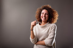 Happy curly south-american woman laughter. On a dark background Stock Images