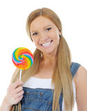 Happy curly  woman with a lollipop Royalty Free Stock Photo
