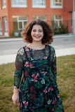 Happy curvy girl with curly hair in the street Stock Photos