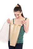Happy customer. Beautiful happy  girl with shopping bag over white background Stock Photography
