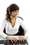 Happy customer care executive with headset Royalty Free Stock Photography