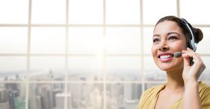 Happy customer care representative woman against city background Stock Photo