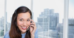 Happy customer care representative woman against city background Royalty Free Stock Photography