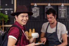 Happy customer drinking coffee Stock Photos