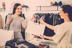 Happy customer in fashion showroom Royalty Free Stock Photo