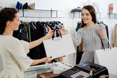 Happy customer in fashion showroom Stock Images