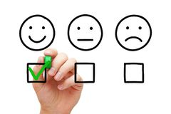 Happy Customer Feedback Survey Concept. Happy customer evaluating with green marker check mark on feedback survey. Client satisfaction business service concept stock photos