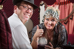 Happy Customer and Fortune Teller Royalty Free Stock Photography