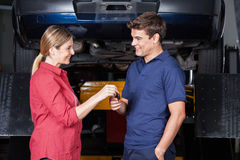 Happy Customer Giving Car Key To Mechanic Stock Image