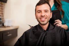 Happy customer at a hair salon Royalty Free Stock Images