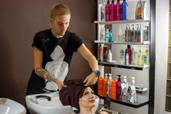 Happy customer at the hairdresser, hair care stock photos