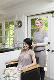 Happy customer with hairstylist in beauty salon Royalty Free Stock Photo
