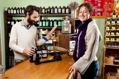 Happy customer in a herb shop Stock Photo
