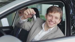 Happy customer holding the keys to his new car stock video