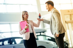Happy customer just bought a car Stock Image