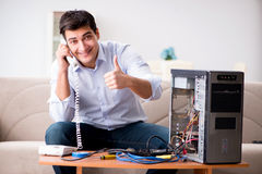 The happy customer resolving his computer problem Stock Image