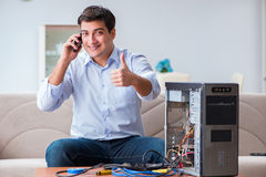 The happy customer resolving his computer problem Stock Images