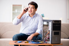 The happy customer resolving his computer problem Stock Photography