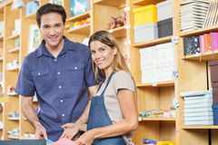 Happy Customer And Saleswoman Standing In Store Royalty Free Stock Images
