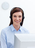 Happy customer service agent with headset on. Against white background Royalty Free Stock Photos
