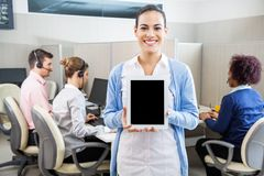 Happy Customer Service Agent Showing Tablet Stock Image