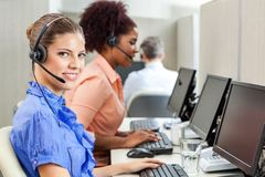 Happy Customer Service Agent Using Computer At Stock Photography