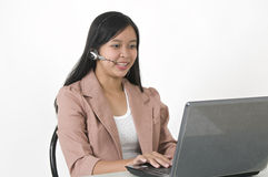 Happy customer service girl. Picture of a happy and contented office customer service staff Stock Photos