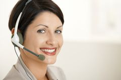 Happy customer service operator. Closeup portrait of happy customer service operator talking on headset Stock Images