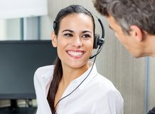 Happy Customer Service Representative Looking At Stock Image