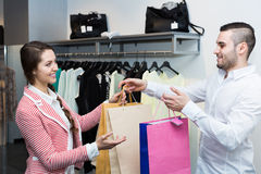 Happy customer with shop assistant. Smiling customer with cheerful shop assistant at boutique Royalty Free Stock Images