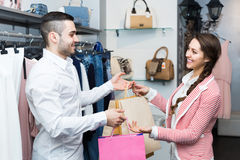Happy customer with shop assistant Royalty Free Stock Photos