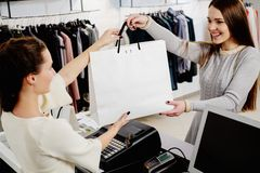 Happy customer with shopping bag. In fashion showroom Royalty Free Stock Photos