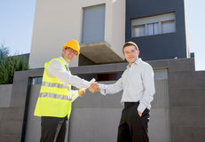 Happy customer smiling and constructor foreman worker shacking hands as agreement Stock Photo