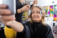 Happy Customer Talking Selfie In Beauty Salon Stock Photos