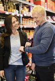 Happy Customers Using Smart Watch In Grocery Store Stock Image