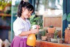 Happy Cute Asian Girl Enjoying with Gardening Activities, A Thre royalty free stock image