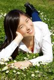 Happy cute asian woman relaxing in spring Royalty Free Stock Images
