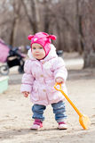 Happy cute baby girl walks in spring park Royalty Free Stock Photos